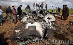 В Ливии сбит первый амриканский самолет: на земле продолжаются бои между войсками Каддафи и мятежниками.